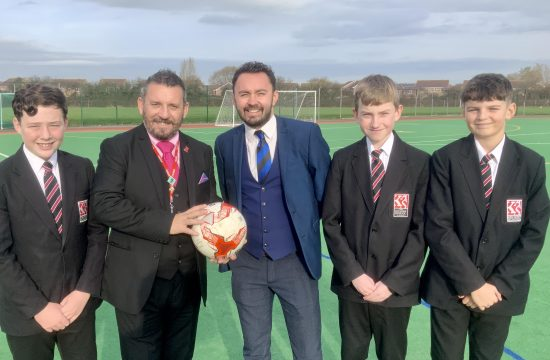 Staff of football club and school together